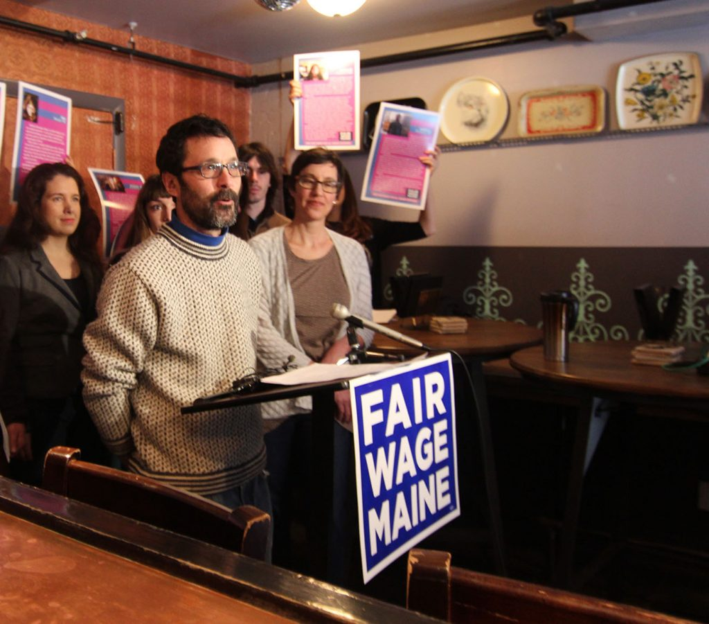Steve Corman, owner of Vena's Fizz House in Portland, speaks in favor of the minimum wage referendum