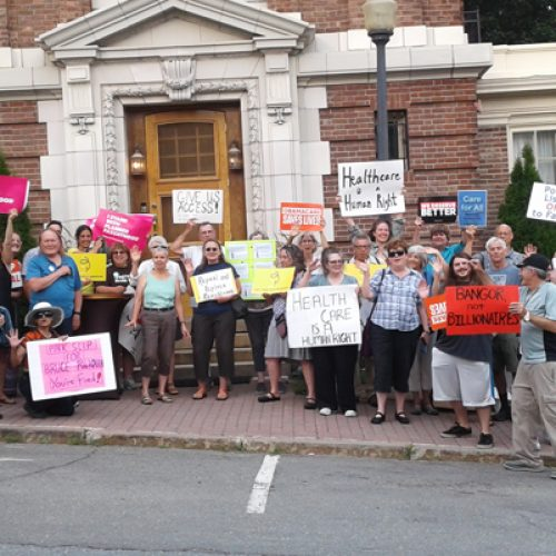Mainers protest Rep. Poliquin's health care repeal vote outside closed-door cocktail reception